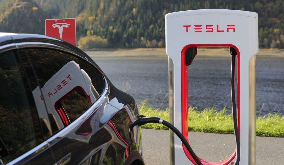 How many solar panels does it take to charge a Tesla